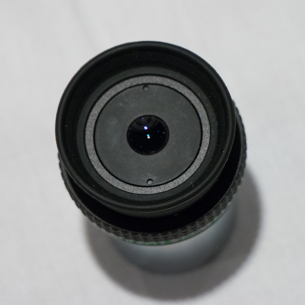 Image showing the muted reflections of a bright light source in the eye lens of the zoom eyepiece.